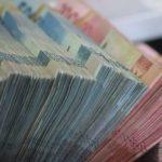 Nilai Tukar Rupiah Melemah ke Rp14.410 per Dolar AS, Apa Penyebabnya?